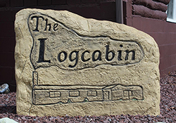 The Log Cabin logo